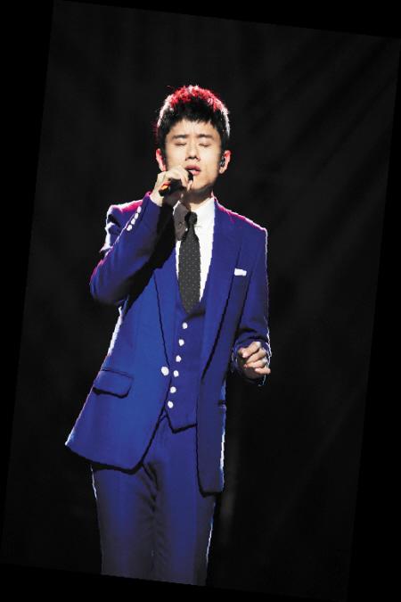 《 我是歌手》第二季张杰现场及海报造型,图片尺寸:600×400,来自网页